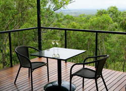 Relax on the deck with a glass of wine and enjoy the panoramic views across the Atherton Tablelands.