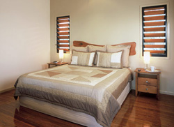 Shimmering bamboo floors blend with the elegant bedroom decor