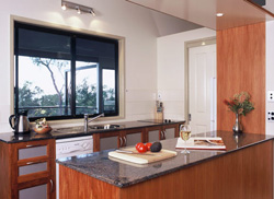 Panoramic views from the spacious granite and timber galley kitchen